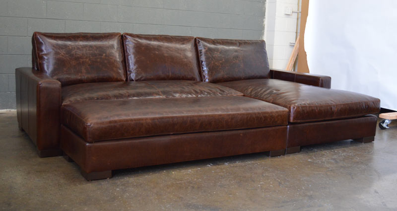 Front Left Angle View Of Braxton Sofa Chaise Sectional Shown With Full Fit Tail Ottoman