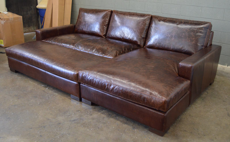 Front right angle view of Braxton Sofa Chaise Sectional shown with Full Fit Cocktail Ottoman