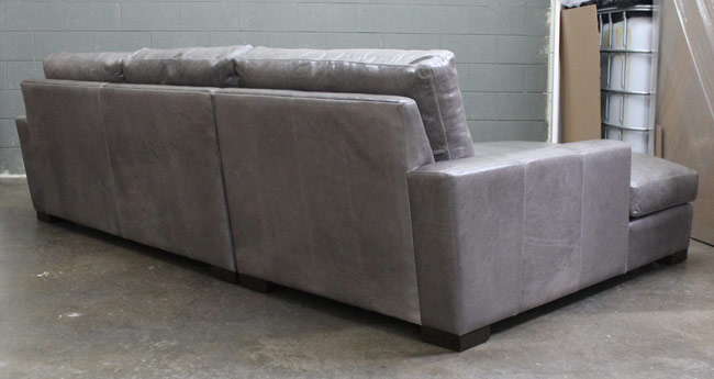 Rear view of the Braxton Leather Sofa Chaise Sectional in Glove / Mont Blanc Timberwolf