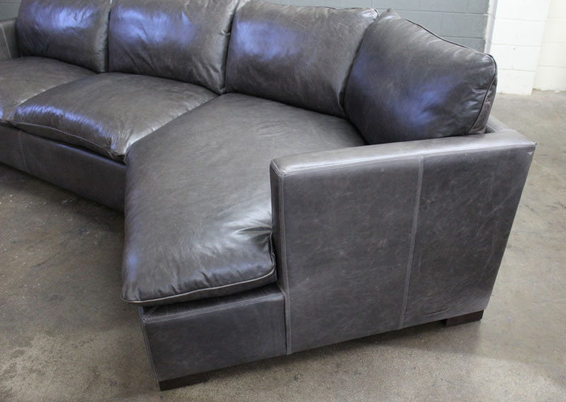 Detail view of the Cuddler on our Reno Leather Sectional Sofa in Glove Mont Blanc Timberwolf