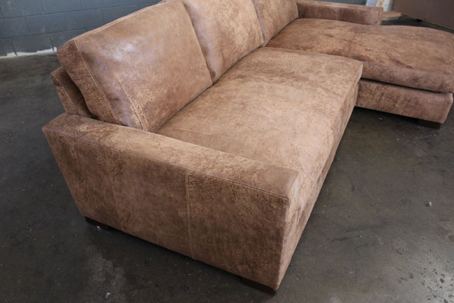 Front angle detail view of Braxton Sofa Chaise Sectional in Italian Destroyed Leather, Ragtime Natural