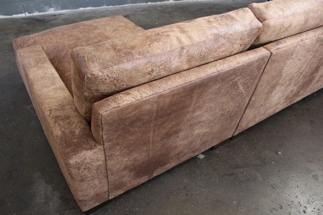 Back detail view of Braxton Sofa Chaise Sectional in Italian Destroyed Leather, Ragtime Natural