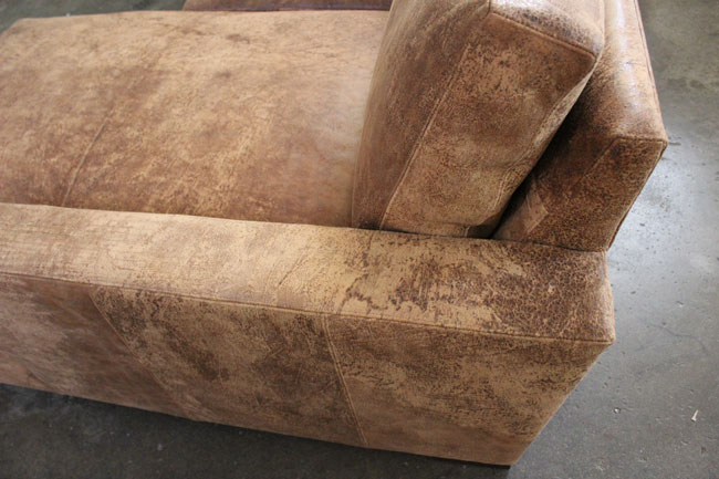 Side detail view of Braxton Sofa Chaise Sectional in Italian Destroyed Leather, Ragtime Natural