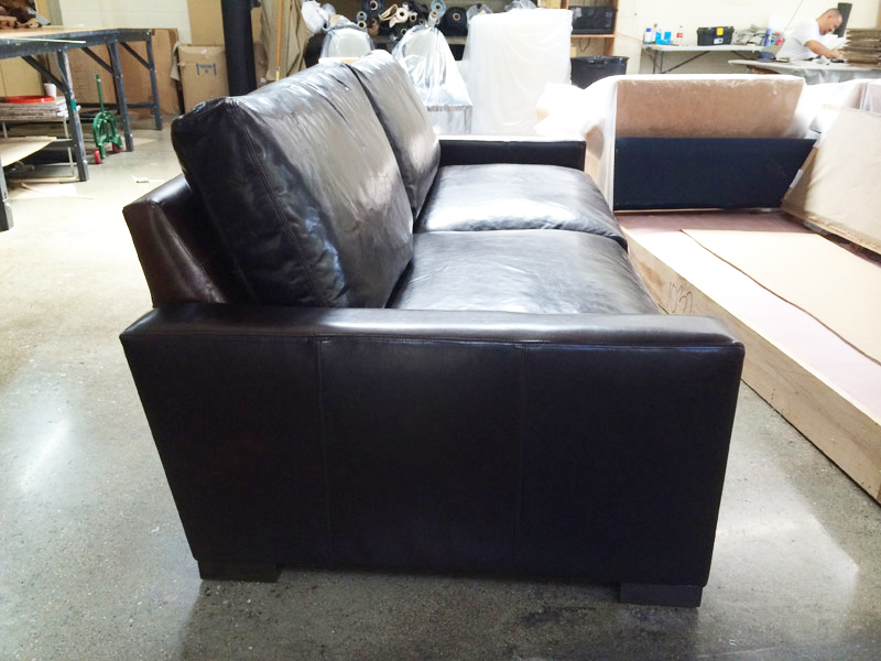 Side view of a 43 inch deep Braxton Twin Cushion Leather Sofa in Italian Brompton Cocoa