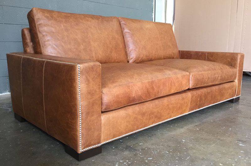 Italian Berkshire Leather on our Braxton Leather Sofa with Nail head trim