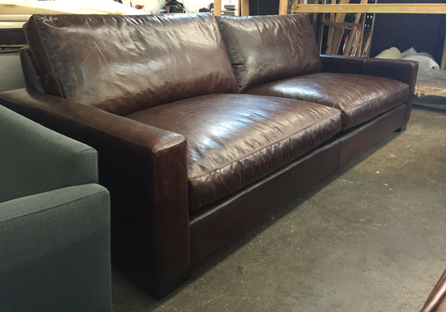 "Accompanying these chairs is a 108"" x 46"" Braxton Twin Cushion Leather Sofa in Italian Brompton Cocoa leather"