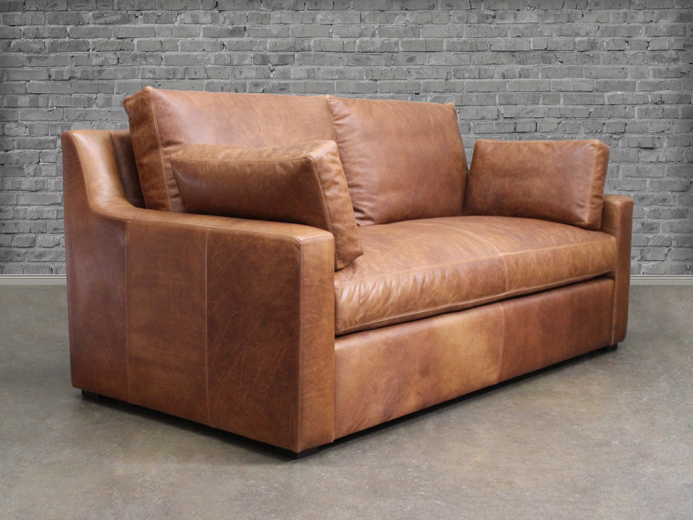 Julien Track Arm Leather Sofa In Italian Berkshire Chestnut Front Angle View With Accent Pillows
